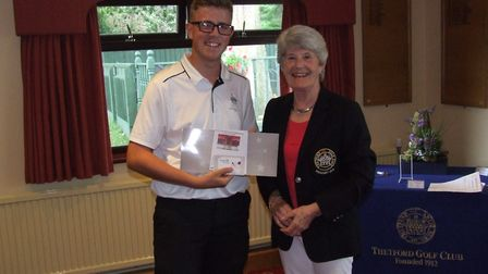 Dean Scott is presented with his prize by Anne McHarg after winning the President's Day morning comp