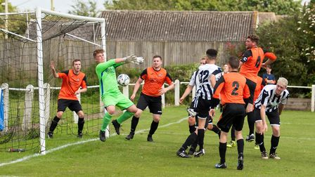 The Bradenham keeper makes an instinctive stop during the friendly against Swaffham Reserves. Pictur