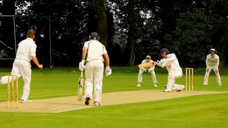 Great Witchingham skipper Sam Arthurton in full flow during Saturday's EAPL clash with Burwell. Pict