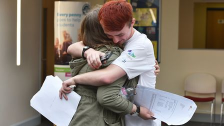 A Level results day at East Norfolk Sixth Form College in Gorleston.Two students congratulating each