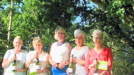 The winners of the Ladies' AmAm at Thetford GC from Ely are pictured on either side of Ladies'' Capt