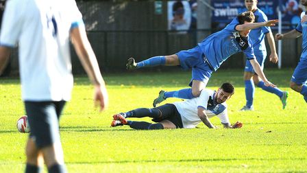 Action from Wroxham (blue) v Haverhill Borough at Trafford Park. Picture: Ian Burt