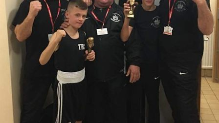 Boxing clever: Youngsters Jaydyn and Harvey Lott with Thetford Town Boxing Club staff. Picture: Club
