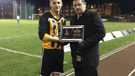 Mitch Forbes receiving his award for making 250 appearances for the Bloaters from club secretary Joh