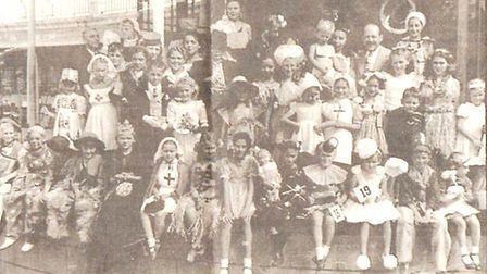 A children's fancy dress competition at the Marina. Band leader Neville Bishop is at the back, secon