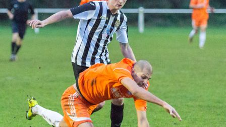 Joe Jackson pressurising the FC Holland defence during Swaffham Town's 4-0 win in Division One of th