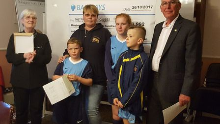 Representatives from Thetford Bulldogs Football Club presented with their grant from councillors Bre