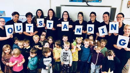 Staff and children at Scribbles Day Nursery celebrate being rated outstanding. Photo: Scribbles Day