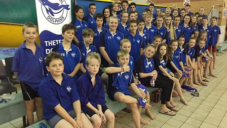 Thetford Dolphins Swimming Club's squad line up for a team photograph at the Tony Gale Memorial Gala