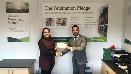 Jorden Knell with Emma Church of Caister Cricket Club.Picture: Persimmon Homes Anglia