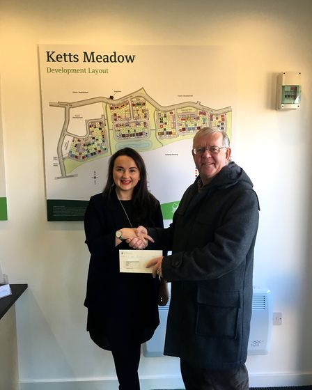 Lucy Woodhall with Stephen Slack of Hethersett Memorial Playing Fields Trust.Picture: Persimmon Home