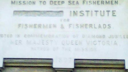 """The stone plaque on the wall with """"Gorleston"""" erased."""
