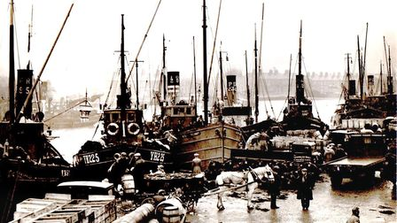 Busy Fishwharf in the 1950s. In the centre, behind the horse, is Bloomfield's Ocean Lifebuoy (YH29),