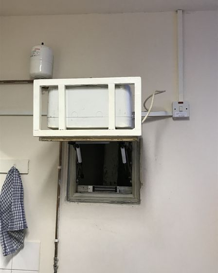 The heater lifted up to reveal a secret compartment.Picture: Norfolk County Council