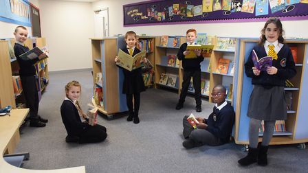 Year Four pupils in Mercury class at Northgate Primary School enjoying the new library in the school