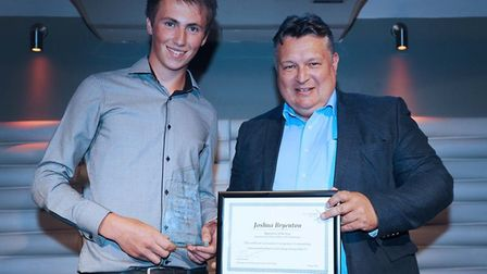 Joshua Bryenton is seen receiving his apprentice of the year award from Mark Bee.Picture: East Coast