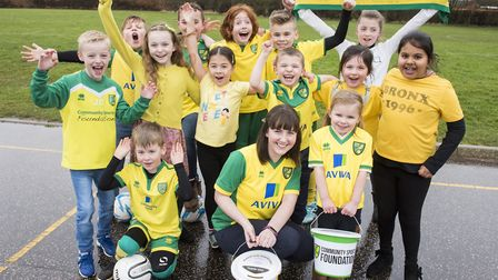 Youngsters at Ludham Primary School dressed in yellow in green for the day to raise funds for the NC
