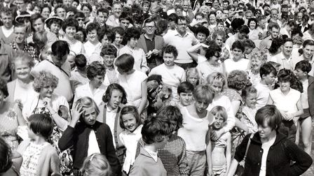 Where's Doddy? Part of the multitude gathered on Yarmouth beach for the rumoured Ken Dodd bid to swi