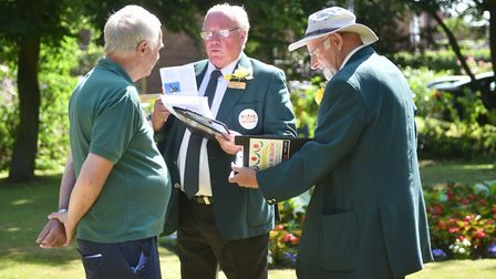 Judging for Anglia in Bloom at Filby. Judges David White (centre) and Nolan Mills (right) with Derek