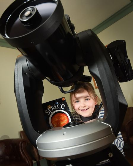 Mulbarton School pupil Amy Fiddeman tries out the telescope.Picture: Angela Sharpe Photography