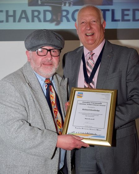 Richard Routledge receiving his superstar award from deputy mayor Malcolm Bird.Picture: Steve Davis