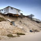 Houses were left hanging over the edge of the dunes. Picture: Antony Kelly