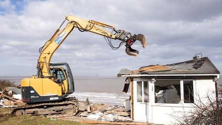 Work has started on the demolition of the homes that are now overhanging the cliff on The Marrams, H
