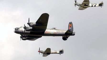 A flypast of three planes from the Battle of Britain Memorial Flight during the International Air Da