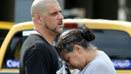 Ray Rivera, DJ at the Pulse nightclub, is consoled by a friend outside of the Orlando Police Departm