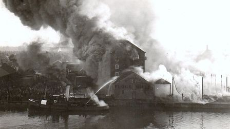 The inferno engulfing Jewson's timber yard and R H Clarke's flour mill in 1928 was watched by thousa