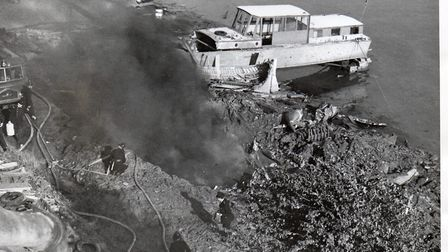 Looking down on the smoking Gorleston riverside crater from one of the damaged houses on the main ro