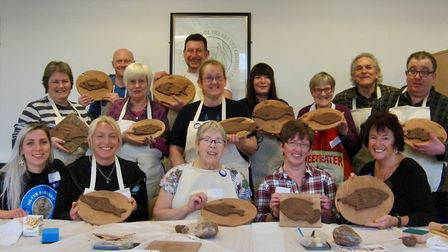 Participants show off their clay skills at the library workshop. Picture: Joshua Grace, Wide Angle P