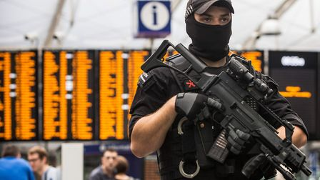 An armed police officer stands at Manchester Piccadilly railway station.