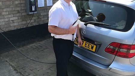 Office manager Danny Day with one of the electric charing points Picture: Long Beach