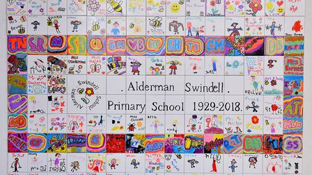 Yarmouth Mayor Mary Coleman unveils a mosaic during the closing ceremony of Alderman Swindell Primar