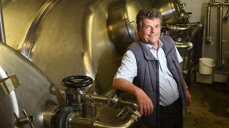 Woodforde's master brewer Neil Bain with fermentation tanks.Picture: ANTONY KELLY
