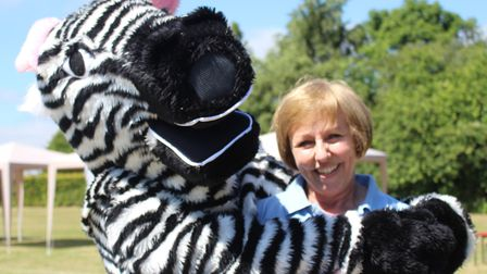 Headteacher Heather Delf with Zac the zebra Brake mascot at a recent fundraising eventPicture: Heath