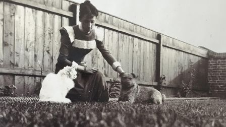 A woman with her pets, pictured in the album. Picture: Sarah Woolley