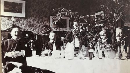 A dinner party pictured in the album. Picture: Sarah Woolley