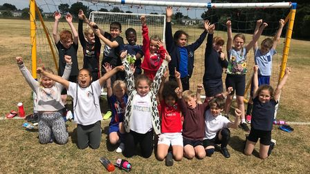 The winning youngsters celebrate football successPicture: Sarah Young