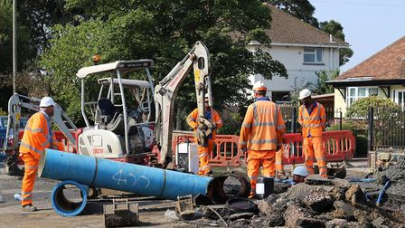 Repairs are under way in Caister Road after two pipes burst on Wednesday evening. Picture: Daniel Cr