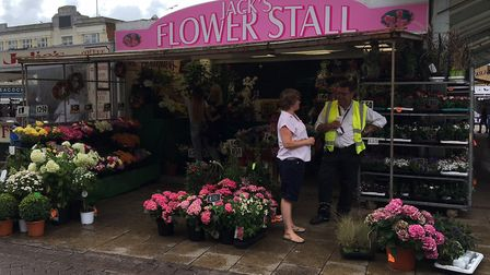 The third generation is now operating Jack's Flower Stall in the market place Pic