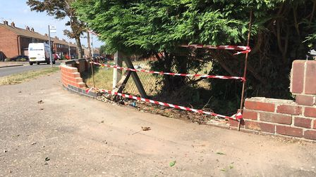 A car is said to have crashed through the wall prior to police arresting four people. Picture: Jaco