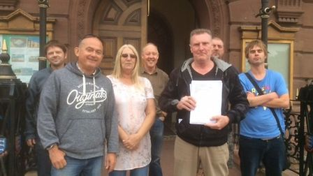 Councillor for Central and Northgate ward, Chris Walch, with the petition opposing proposals to move