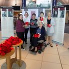 The knit and natter group hand over the poppiesPicture: Jackie Tierney