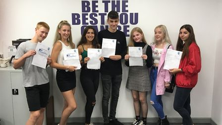 Pupils of Caister acdemy celebrate their GCSE results: Daniel Johnstone, Isabella Weller, Kitty Robi