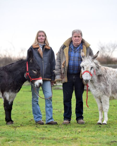 Trevor Austin and Kara Barber with two of the donkeys that are now on a strict post-Christmas diet a