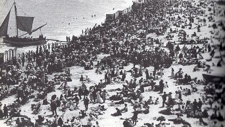 High summer and a crowded shore, but nonetheless many men wore suits even to enjoy Great Yarmouth's