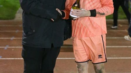Great Yarmouth Town's man of the match Josh Glover receives his award from John Lewsley Picture: STE