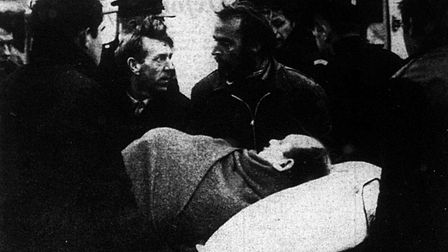 One of the casualties being carried on a stretcher.